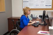 Female-receptionist-using-wheelchair