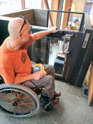 Man-using-wheelchair-using-wheelchair-elevator