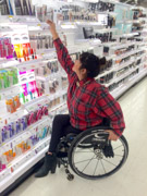 Young-woman-using-wheelchair-shopping-for-beauty-products