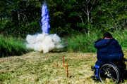 Man-using-wheelchair-on-shooting-range